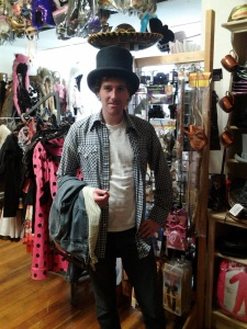 Zac with a hat in Solstice vintage and costume shop