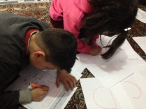 Syrian kids doing ABCs