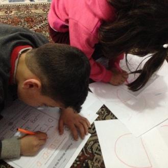 Syrian kids doing ABCs