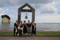 Our crew with the friendship bell. Photo courtesy of Jenny Lee.