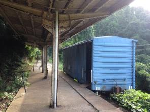 The train car and umbrella trail. Shot on iphone.