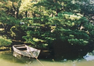 A rowboat in autumn. Shot on film.