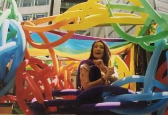 Rainbow balloons on one float. Shot on film