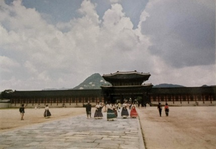 Hanbok-clad tourists in front of the palace. Shot on film.